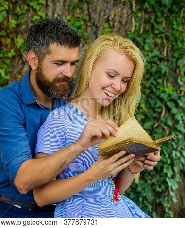 Romantic Couple Holds Old Book With Poems About Love.
