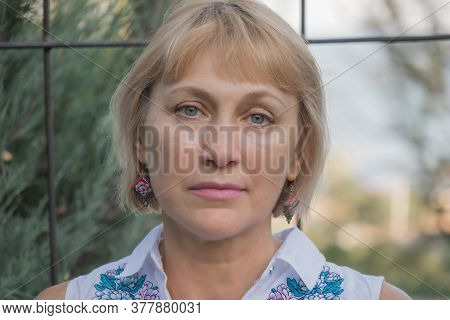 Summer Portrait Of Lovely Cute Pretty Fifty Year Old Blonde With Sad Look
