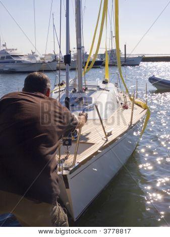 Men Grabbing Intoo A Ship