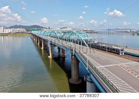A bridge over Han river with a subway train