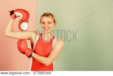 Punctuality And Personal Efficiency. Girl Boxer Hold Alarm Clock. Morning Energy. Establishing The C