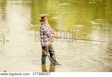 Retired Fisherman. Male Leisure. Fisherman With Fishing Rod. Activity And Hobby. Fishing Freshwater