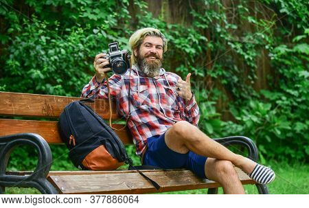 Photographer Use Vintage Camera. Bearded Man Hipster Taking Photo. Man With Retro Camera. Camera Set
