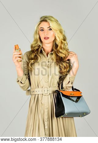 Fashion And Beauty. Lady Prefer Expensive Fragrance Smell. Sexy Girl Has Curly Hair Hold Bag. Woman