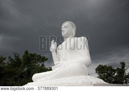 Mihintale, Sri Lanka - Circa 2018: Big White Buddha Statue Against Blue Sky In Mihintale, The Cradle