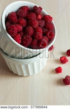 Crockery With Beautiful Tempting Raspberries. High Quality Photo