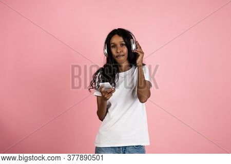 Listen To Music. Cheerful African-american Young Woman Isolated On Pink Background, Emotional And Ex
