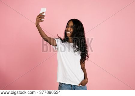 Taking Selfie. Cheerful African-american Young Woman Isolated On Pink Background, Emotional And Expr