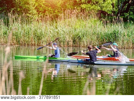 Three Guys Floating In A Canoe On The River