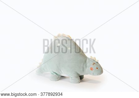 Soft Light Green Plushie Doll Stegosaurus Dinosaur Toy. Object Isolated On White Background With Sha