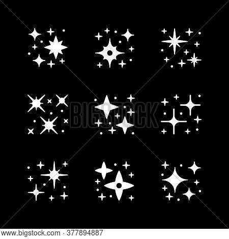 Set Icons Of Sparkling And Twinkling Isolated On Black. Vector Illustration