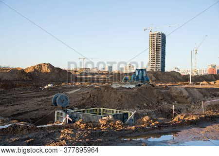 Bulldozer At The Large Scale Construction Site On Tower Cranes Background. Installation Of Concrete