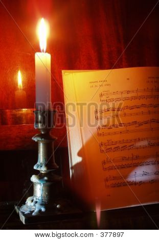 Piano And Sheet Music In The Candle Lighting