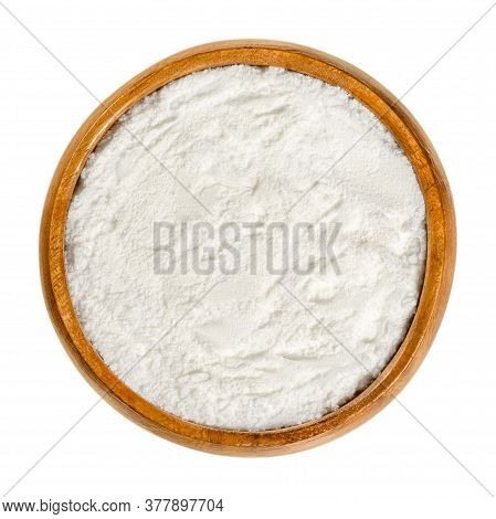 Baking Powder In Wooden Bowl. White, Dry Chemical Leavening Agent. Mixture Of Carbonate Or Bicarbona