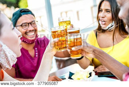 Friends Toasting Beer Glasses With Opened Face Masks - New Normal Lifestyle Concept With People Havi
