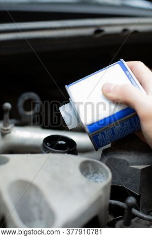 Checking And Refilling Fluid Levels In The Car, Closeup. Vehicle Check-up. Under The Hood Of A Car V