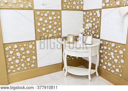 Luxury House Interior In Light Shades With Vintage Wooden Commode In Corner. Pictures In Photo Frame