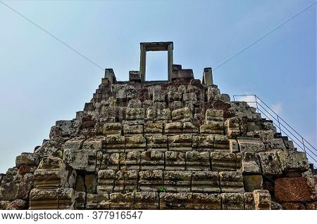 The Architecture Of Ancient Angkor. An Open Door To Heaven. The Upper Part Of The Temple Is In The F