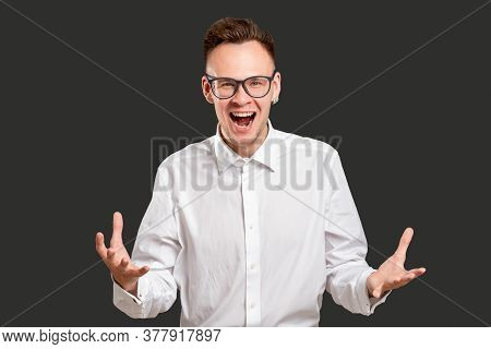 Astonished Man Portrait. Exciting Opportunity. Amazed Millennial Guy Yelling Happy To Win Profession
