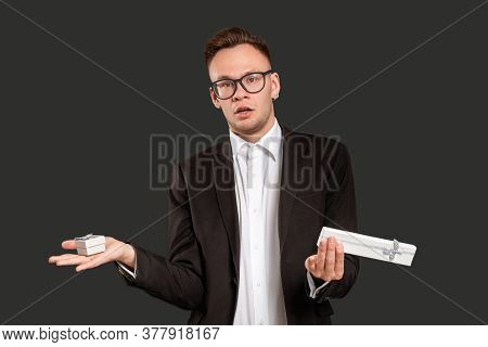 Special Gift. Birthday Surprise. Confused Business Man Troubled Choosing Present Holding Jewelry Box