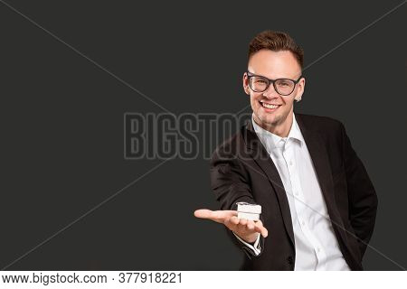Special Gift. Marriage Proposal. Cheerful Handsome Guy In Suit Offering Jewelry Box Smiling Isolated