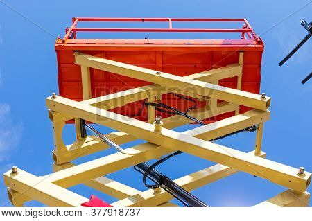Tall Scissor Lift Platform Machine At Construction Site