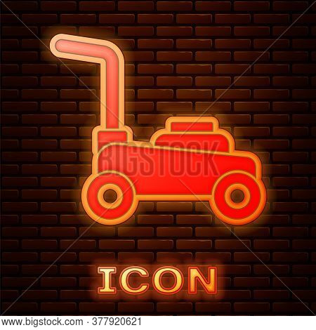 Glowing Neon Lawn Mower Icon Isolated On Brick Wall Background. Lawn Mower Cutting Grass. Vector
