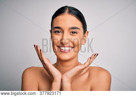 Close up of young beautiful woman with clear and pure skin. Perfect and clean skincare wearing natural makeup. Smiling happy looking fresh and healthy.