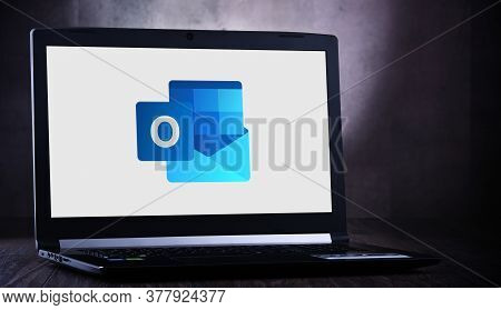 Poznan, Pol - Jul 11, 2020: Laptop Computer Displaying Logo Of Microsoft Outlook Program, Part Of Th