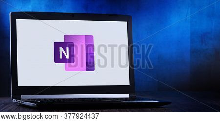 Laptop Computer Displaying Logo Of Microsoft Onenote