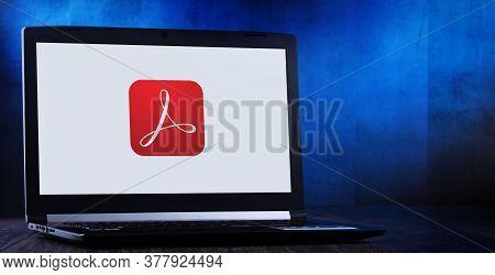 Laptop Computer Displaying Logo Of Adobe Acrobat