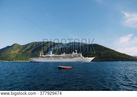 Cruise Liner Against The Backdrop Of The Mountain