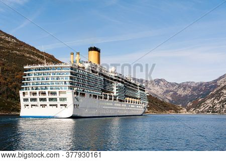A Tall, High-rise Huge Cruise Liner In The Verige Strait, In The Boka Kottorska - Kotor Bay In Monte