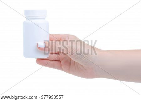 White Jar With Pills Capsule Medicine Pharmacy In Hand On White Background Isolation
