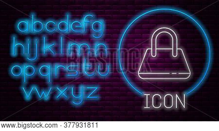 Glowing Neon Line Handbag Icon Isolated On Brick Wall Background. Female Handbag Sign. Glamour Casua