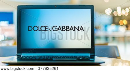Laptop Computer Displaying Logo Of Dolce & Gabbana