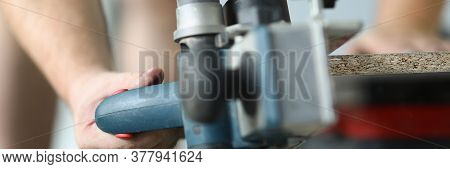 Close-up Of Professional Worker Cutting Wood With Special Electrical Equipment. Qualified Foreman Wo