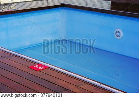 Empty Pool Without Water In Summer. Pool Of Blue Color Without Water