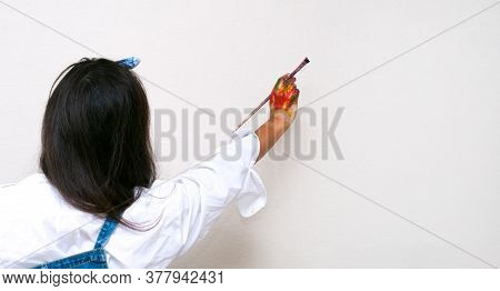 Female Artist Hand Painted In Colorful Paints Holding A Paintbrush. Place For Text, Banner, Copy Spa
