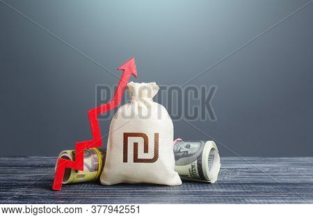Israeli Shekel Money Bag And Red Arrow Up. Growth Of Economy And Increase Of Investment Attractivene