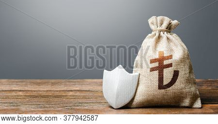 Turkish Lira Money Bag And Protection Shield. Ease Doing Business. Recovery After Crisis. Guaranteed