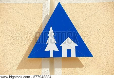 Blue Youth Hostel Sign With Pictogram Of A Tree And House, A Form Of Low Cost Lodging