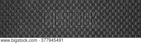 Texture Of Black Fabric Embroidered In A Checkerboard Pattern.background Of Dense Black Fabric Patte