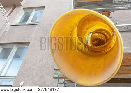 Yellow Telescope Rubble Chute. Plastic Garbage Chute Fixed On Facade. Repair In Apartment, Office Of