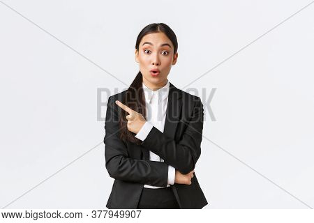 Surprised And Intrigued Asian Female Entrepreneur Asking Question About Product, Standing Interested
