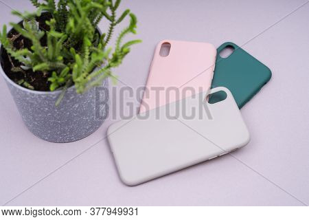 A Few Silicone Cases For The Smartphone. Grey, Green And Pink Smartphone Cases. Protect Your Phone.