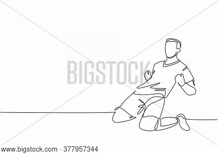 One Continuous Line Drawing Of Young Sporty Soccer Player Sliding On The Field Emotionally After Sco