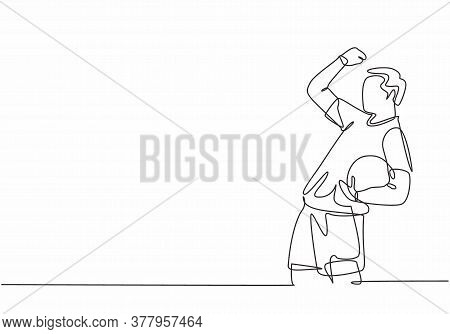 One Continuous Line Drawing Of Young Soccer Player Celebrating Goal Keeping Ball On His Hand And Pun