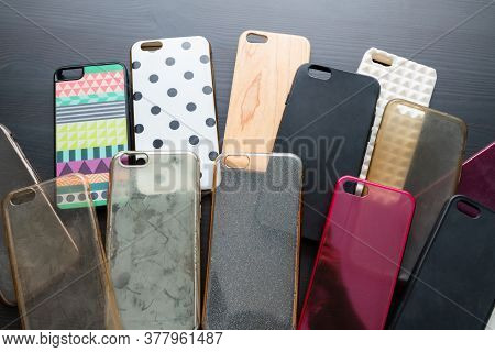 Pile Of Multicolored Plastic Back Covers For Mobile Phone. Choice Of Smart Phone Protector Case Acce