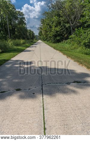 Long Concrete Roads Of Route 66 Now Much Unused Disappear Straight Into Distance With Grass In Crack